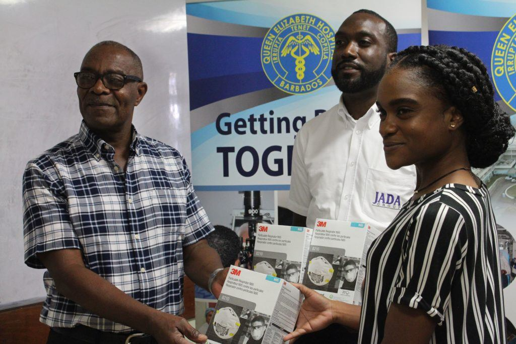 Nigel Whitehall (Board member, QEH) receiving the N95 masks from Group Marketing Manager, JADA Group - Alicia Griffith and Quantity Surveyor Renaldo Eugene-1